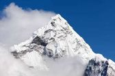 Mount Ama Dablam within clouds, way to Everest base camp