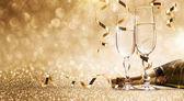 Priorità bassa di celebrazione di Capodanno con champagne