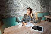 Female economist  sitting with laptop