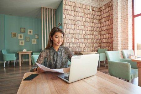 Beautiful Chinese woman using laptop computer
