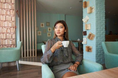 Business woman sitting near the window