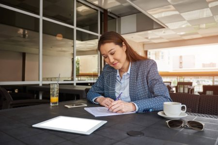 Young woman skilled manager holding paper documents