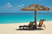 Very relaxing tranquil Caribbean view with a thatch umbrella and chaise lounge