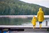 Woman and child in yellow raincoats