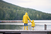 Woman and her son standing on pontoon bridge