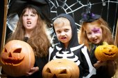 Children with wicked faces holding pumpkins