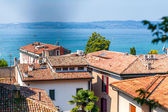 Landscape Lake Garda with houses in the foreground, Italy