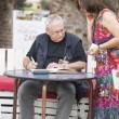Постер, плакат: Wroclaw Poland June 28 2014 Andrzej Sapkowski sign a Witcher book for the fan Authot of The Witcher series book in Wroclaw Poland June 28 2014