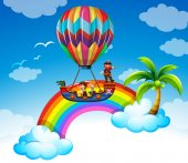 Kids riding on balloon over the rainbow illustration