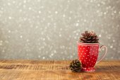 Cup and pine corns decoration