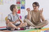 Professional babysitter with a school-boy