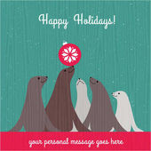 Holiday Christmas card with cute sea lion family and space for your text