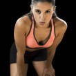 Постер, плакат: latin sport woman posing in fierce and badass face expression with fit slim body
