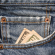 Постер, плакат: Money in Levis jeans pocket