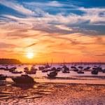 Постер, плакат: Serene sunset over boats at Sandbanks Poole Dorset near Bourne