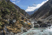 Ama Dablam mountain peak and small river, Everest region, Nepal