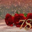 Постер, плакат: Birthday concept with red roses on wooden desk seventy eighth 78th 3D render