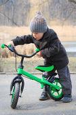 Little boy learns to ride a run