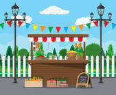 Traditional wooden market food stall full of groceries products with flags crates and chalk board Vector illustration in flat style