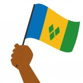 Hand holding and raising the national flag of Saint Vincent and the Grenadines