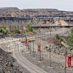 Постер, плакат: Railway tracks for transportation of iron ore Large iron ore opencast mine