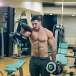 Постер, плакат: Man training barbell in the gym