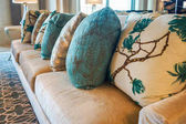 Dubai. Summer 2016. Painted embroidery on the cushions in hotel interior Four Seasons at Jumeirah.