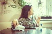 Girl making inhalation, breathe through the inhaler treatment of