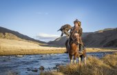 Mongolian nomad eagle hunter on his horse