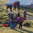 Постер, плакат: People taking pictures of the puffins