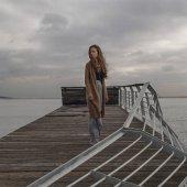 Girl at the old ruin berth at sea