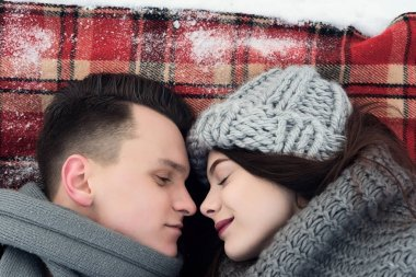 love couple on a plaid in winter