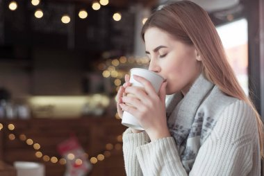 woman drinking coffee at a cafe