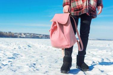 Girl holding pink backpack
