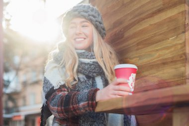 Girl with coffee cup outdoors