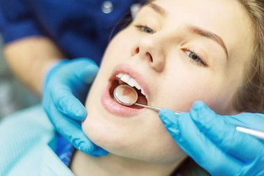 Close up view of open mouth during oral checkup at the dentist