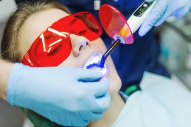 Close-up portrait of a female patient visiting dentist for teeth