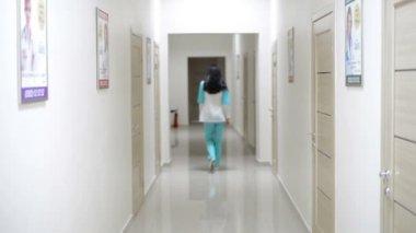 Nurse Doctor Goes On The Hallway Of Hospital