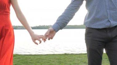 Happy couple walks holding hands