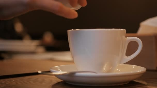 pouring stream milk into a cup of espresso