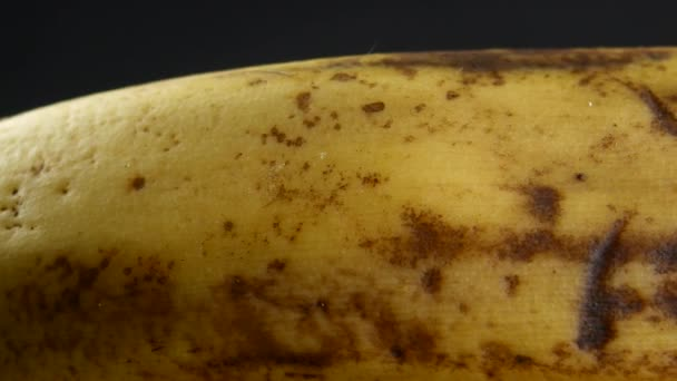 Banana skin extreme close up stock footage. Banana skin surface in macro close up with a sliding camera move