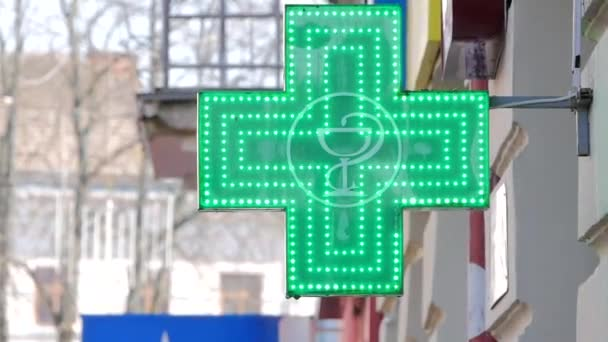 EUROPEAN PHARMACY SIGN: The green cross, often animated, is a symbol found in many countries in Europe