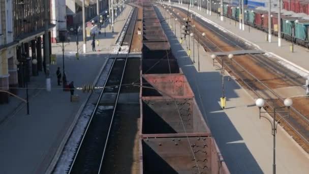 freight train, empty wagons, train station