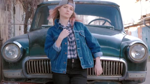 fashion portrait of beautiful sexy woman model girl posing standing near old car in retro style