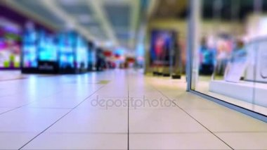 Low angle view of the walking in the modern shopping mall