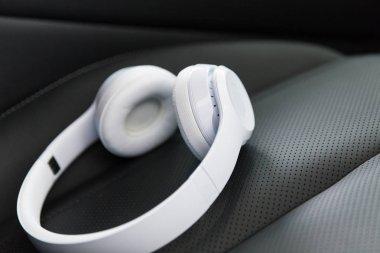 Wireless headphones on the car seat
