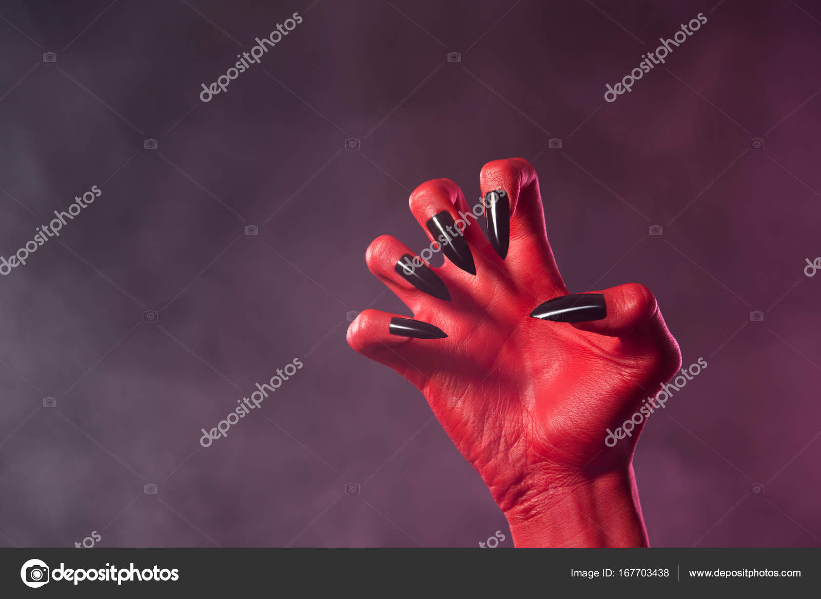 red devil hand with black nails stock photo elisanth 167703438