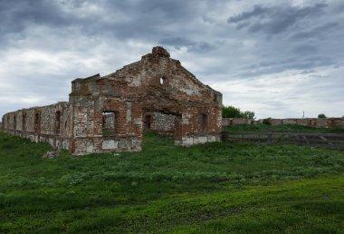 dilapidated brick barn