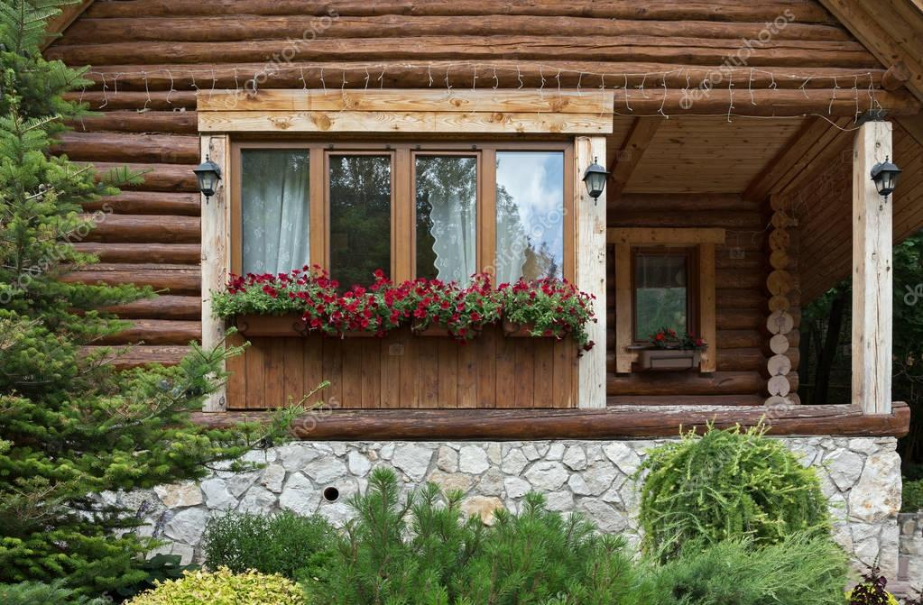 Window with flowers in chalet