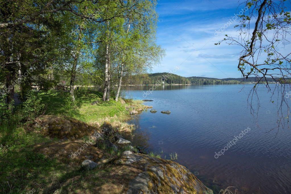 Фотообои picturesque landscape on shore of lake in Karelia
